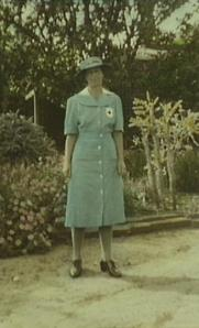 In Red Cross Volunteer Aid Detachment uniform during World War II. Taken in her garden in Exeter Street.