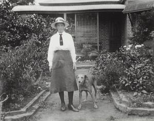 A young Miss Davies in 1916, shadowed, as she would throughout her life, by her pet dog.