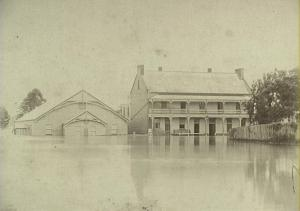 Flood water inundating Drill Hall and Crown Hotel, at corner of Argyle and Murray Streets in the centre of Camden. 1898.