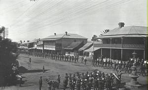 Soldiers marching in a procession along Argyle Street with band playing.