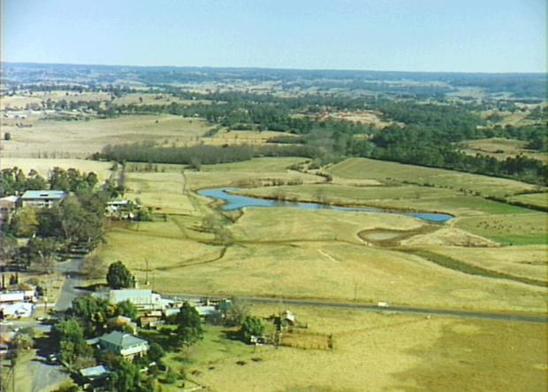 Miss Davies' dairy farm, winter 1994. Exeter Street to left, Macquarie Grove Road in foreground. Looking west. Copyright: Camden Historical Society.