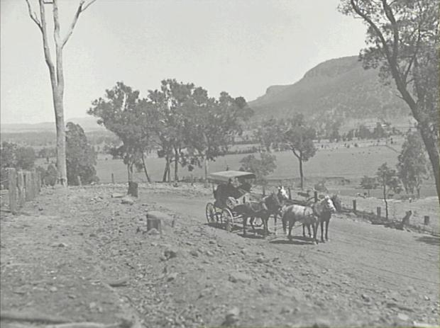 A Butler four-horse coach on a road in Burragorang Valley. Copyright: Camden Historical Society.
