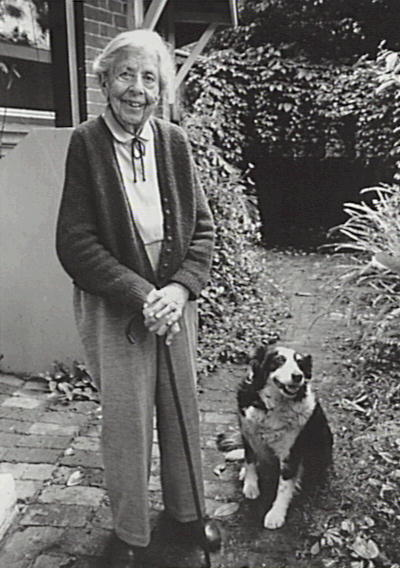 Llewella Davies In her garden, with her faithful dog Tess, at nanat Gwylan. Copyright: Camden Historical Society.