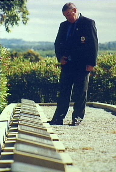 War Cemetery Cawdor Road Camden. This Cemetery contains the remains of Air Force personnel killed while based at Camden Aerodrome during World War II. Phil Flack President Camden RSL inspecting. 1998. Copyright: Camden Historical Society.
